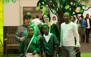 Students pose for photo with Believe Tree