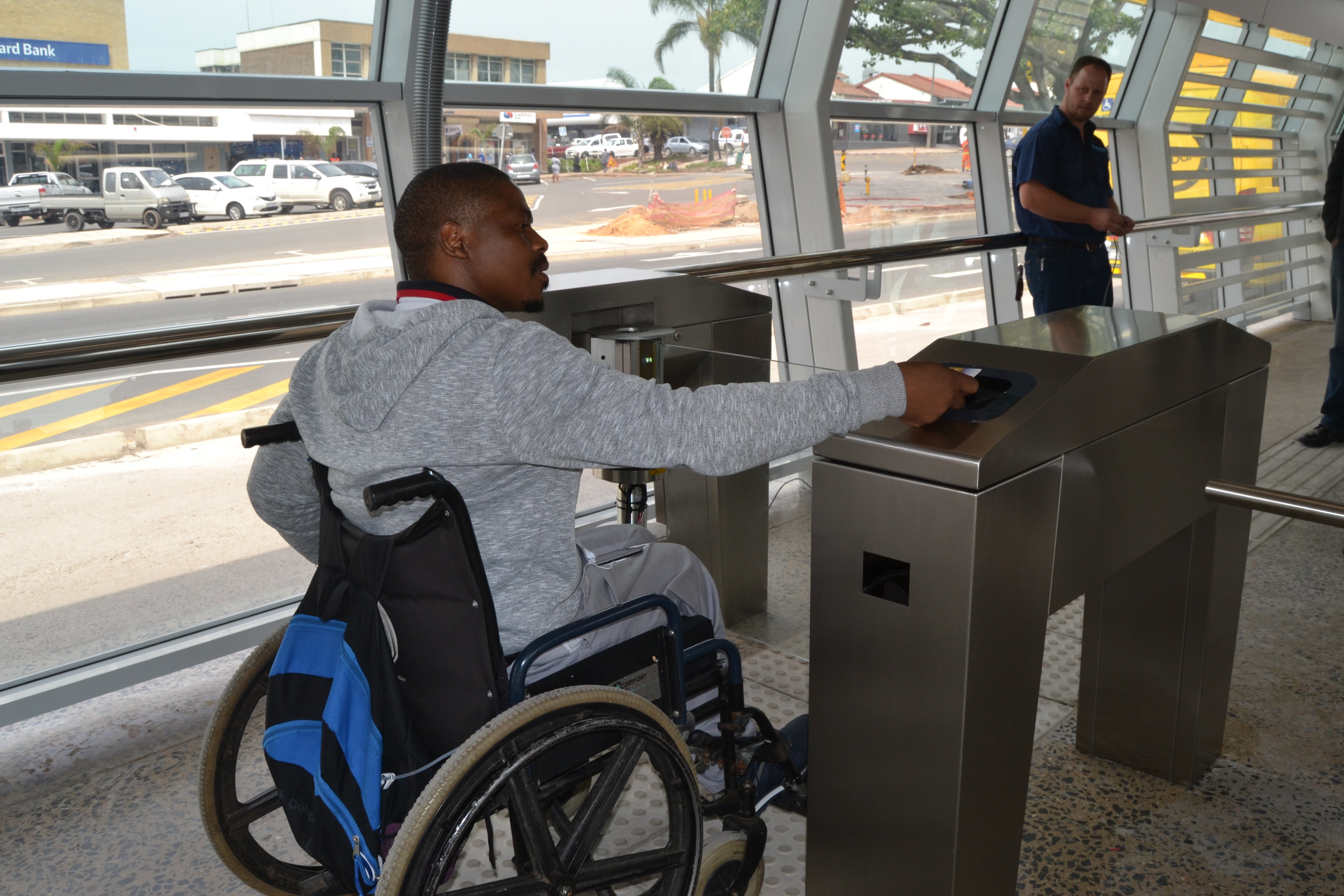 Musa Ngcobo, who works at the Transport Management Centre at the eThekwini Transport Authority, helps to test the control access points for those in wheelchairs at the GO!Durban station at Regent Street, New Germany.